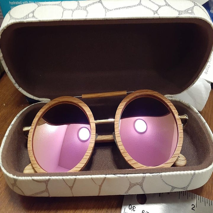 a pair of large round sunglasses in the case