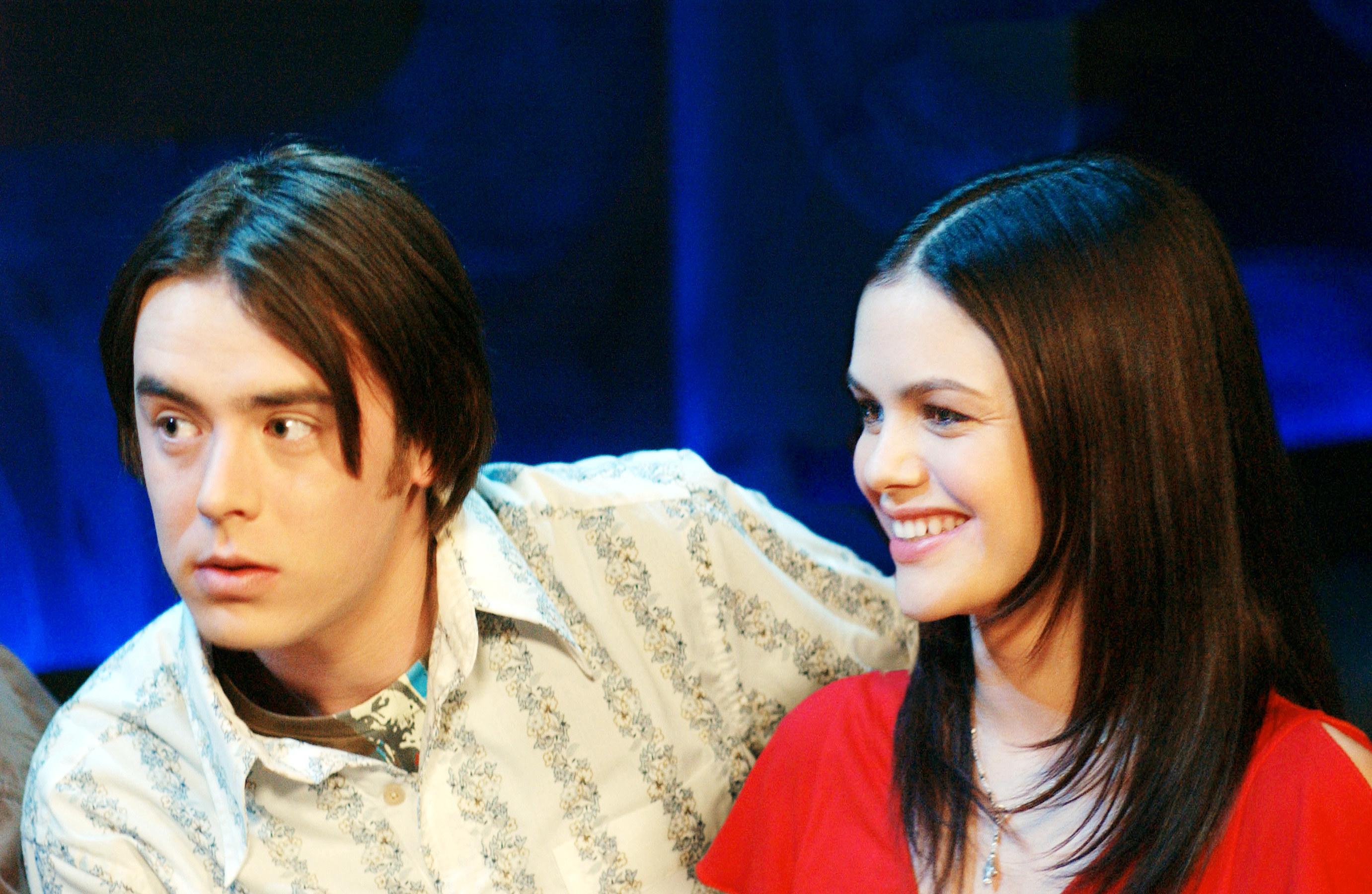 Colin/Grady sitting next to Rachel