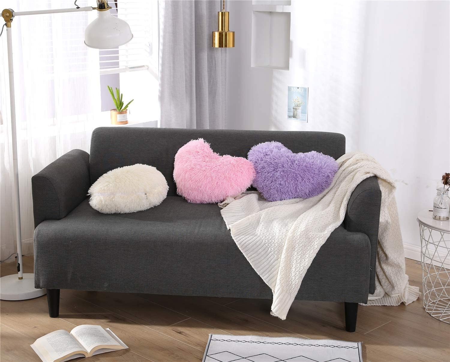 A couch with heart-shaped pillows on it