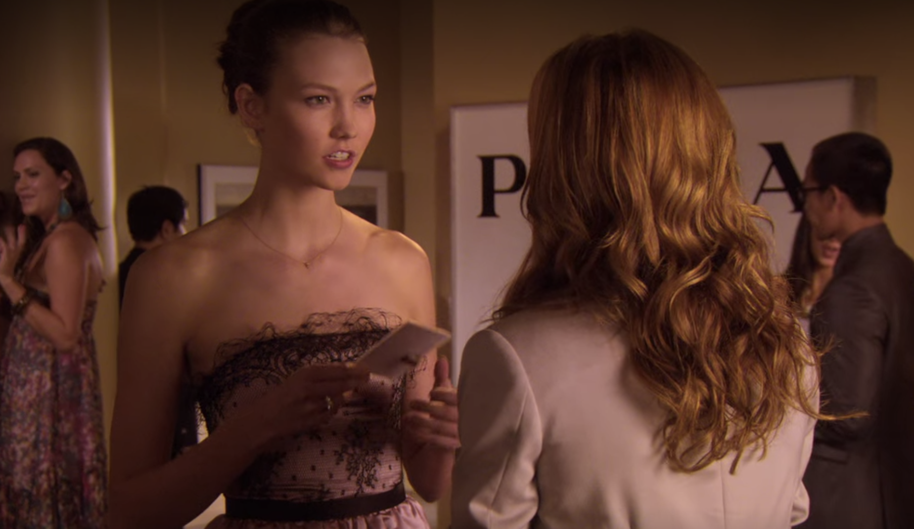 Karlie Kloss accepts a card from Juliet at Lily's house