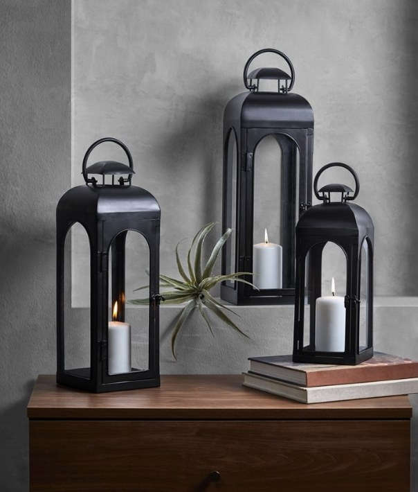 Three black candle lantern cages