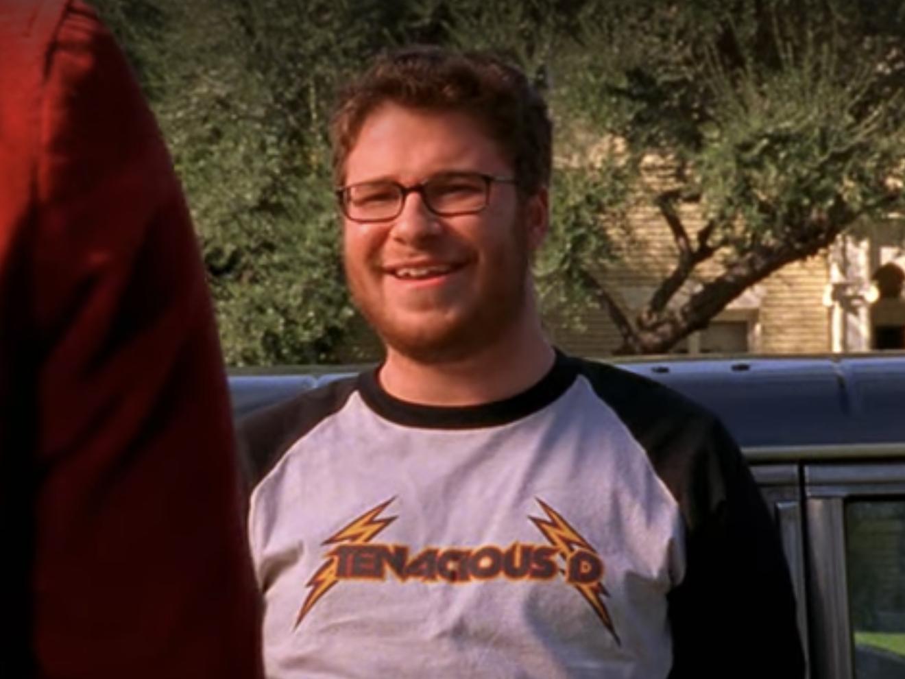 Seth as Bob outside a car