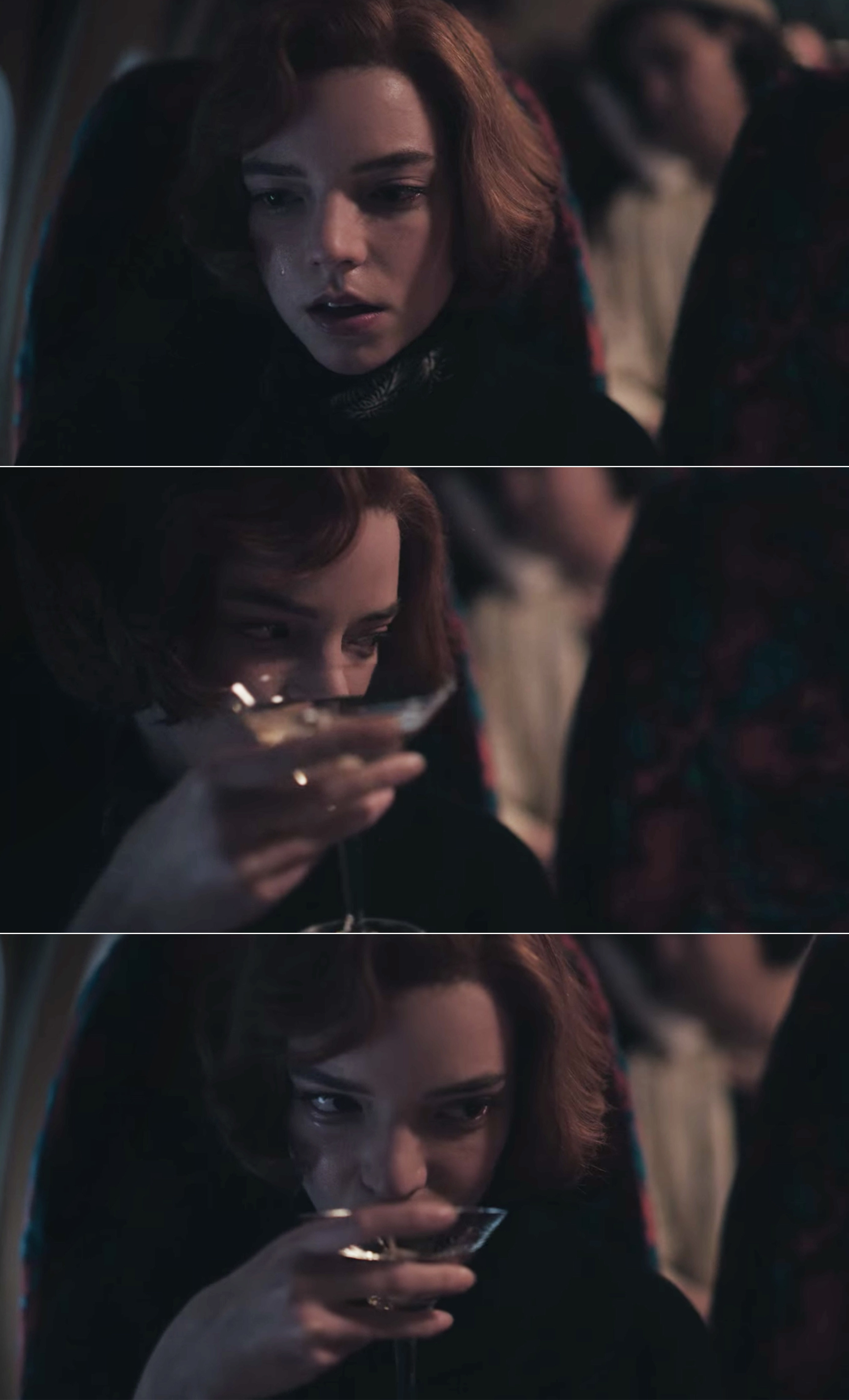 Beth crying and drinking a martini on a plane