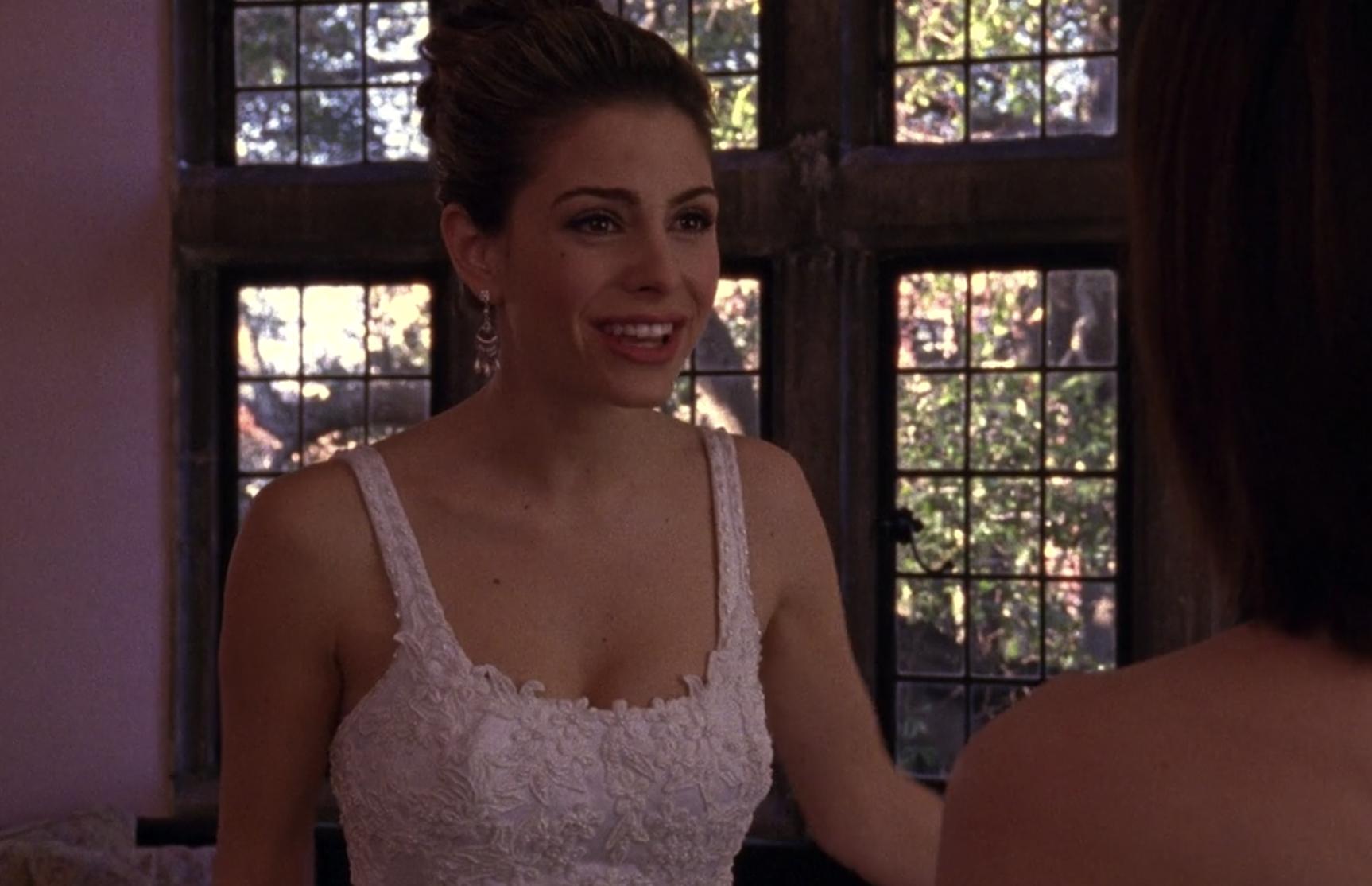 Maria in a wedding dress as Jules