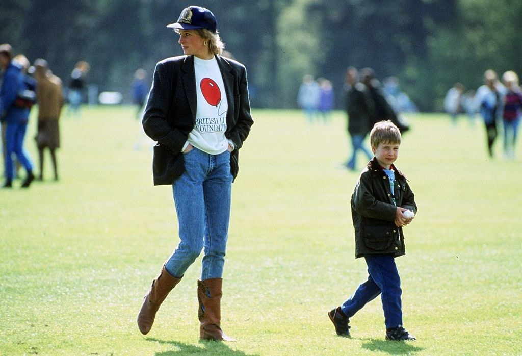 Princess Diana walking with a young Prince William