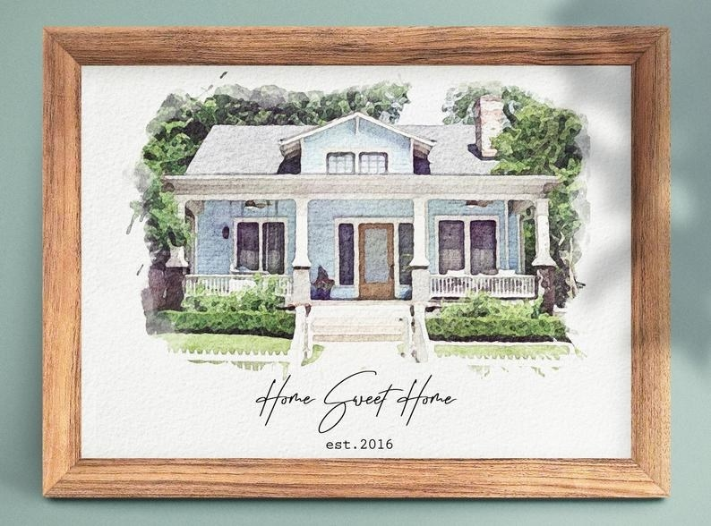 "A framed watercolor painting of a house with text that reads ""Home sweet home est. 2016"""