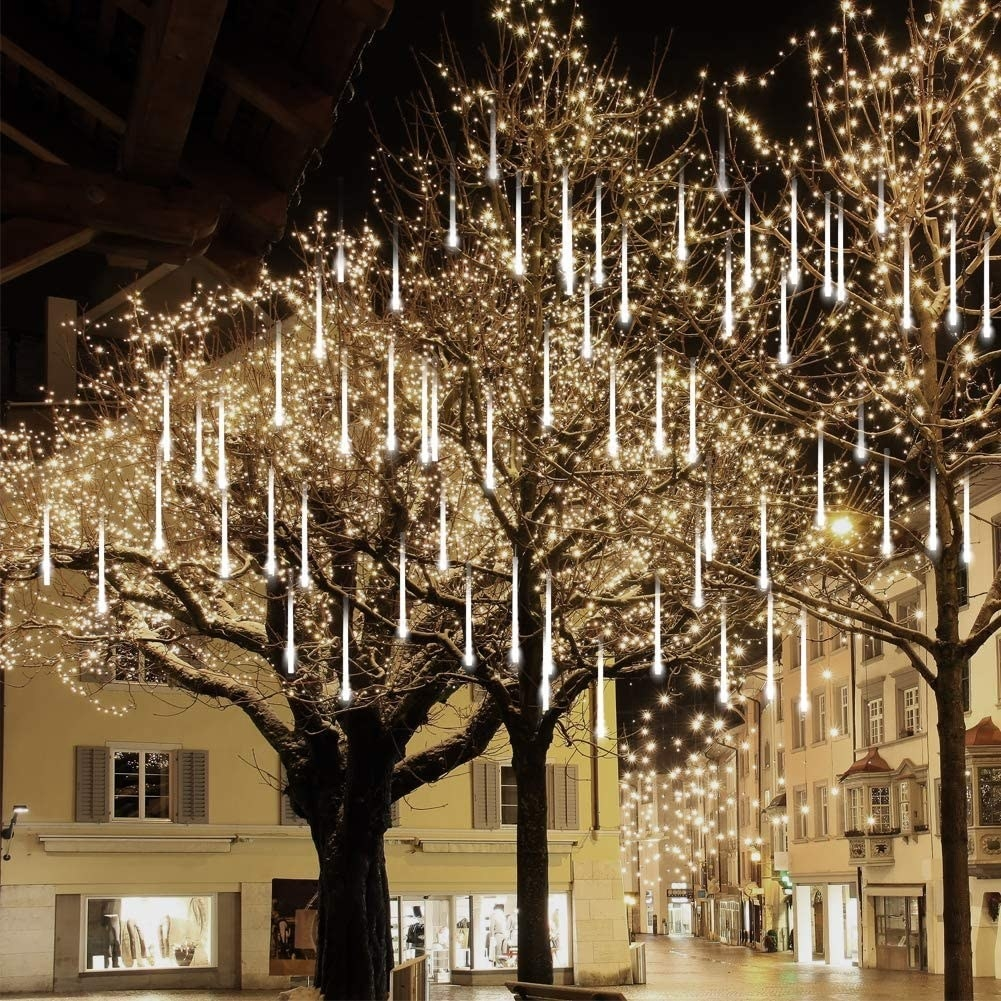 A tree covered in draping icicle lights