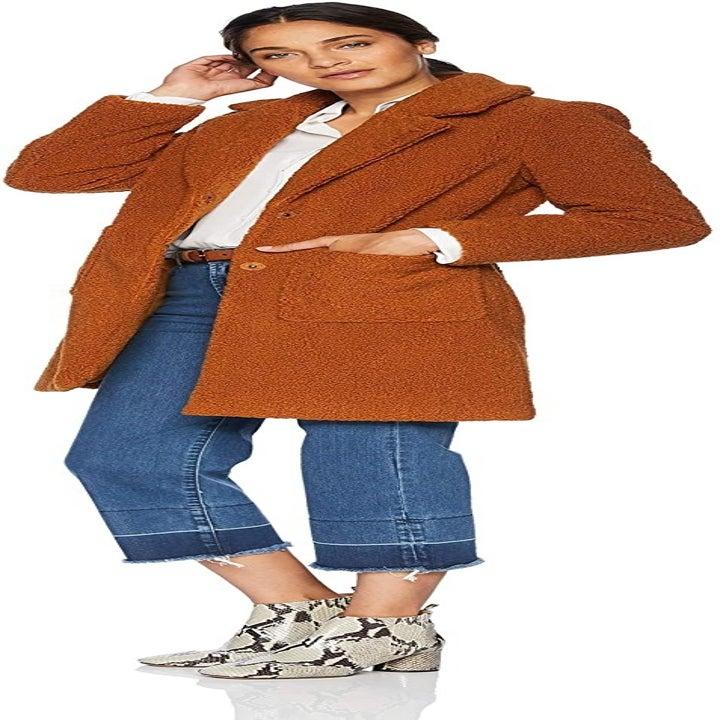 A model wearing the coat in cognac