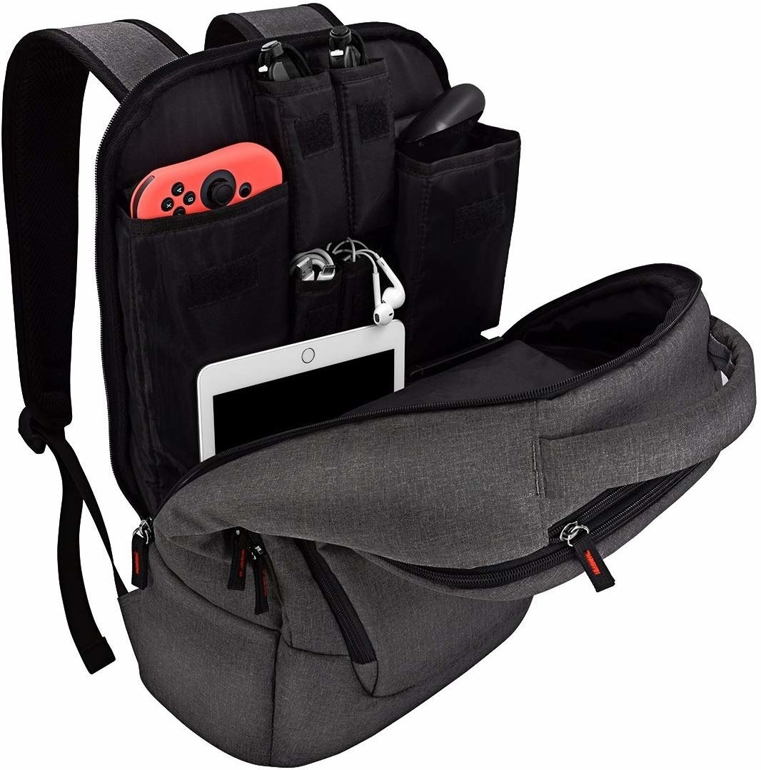 An unzipped backpack with a Switch pocket, controller pocket, ipad pocket, and cables and headphones pockets