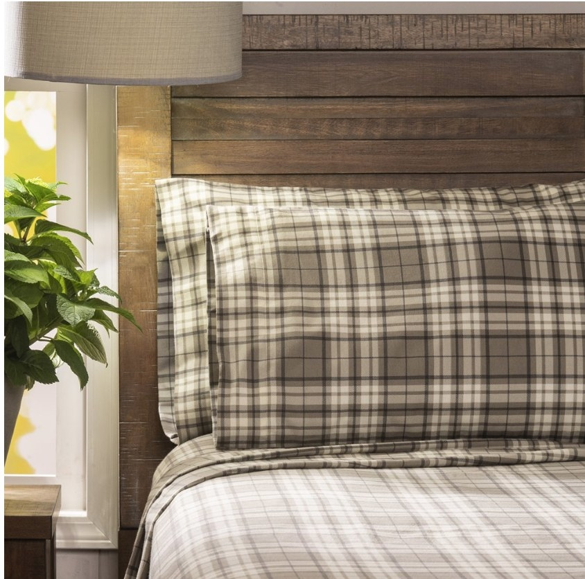 Earth toned plaid flannel sheets on bed