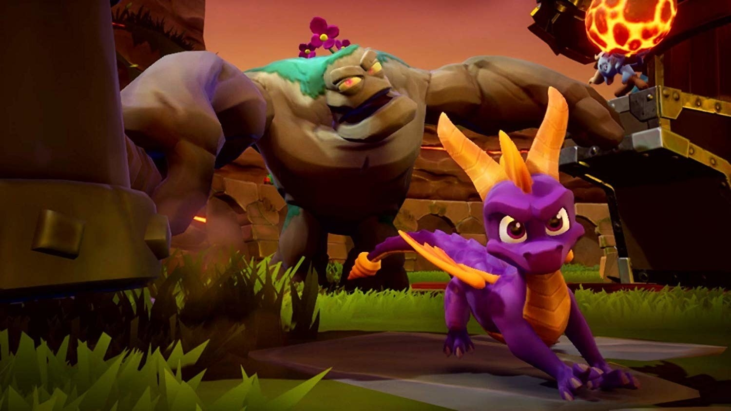 Spyro running toward the camera with a large rock monster in pursuit