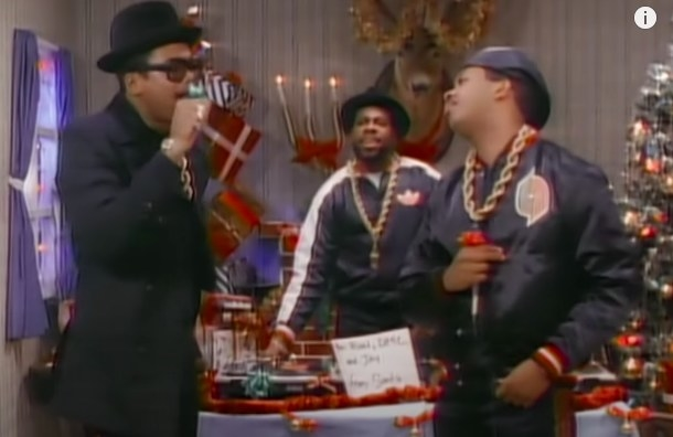 Run DMC perform in a room decorated for Christmas