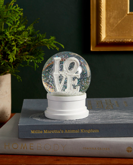 A snow globe with the word LOVE inside