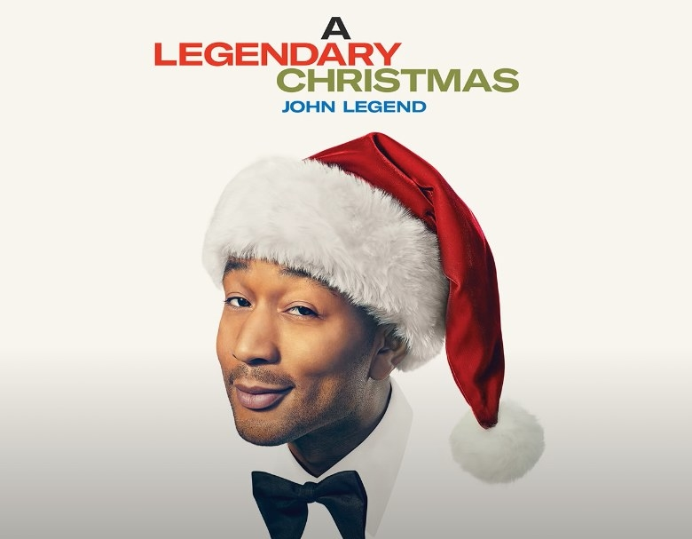 "Cover of ""A Legendary Christmas"" album by John Legend featuring John Legend wearing a Santa hat"