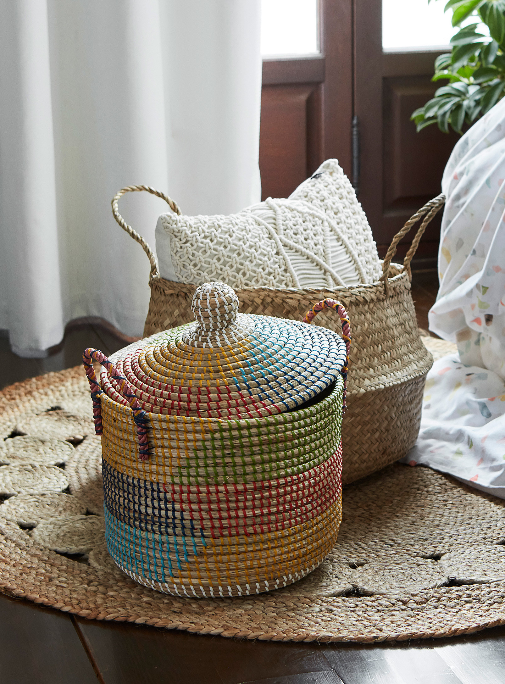A woven basket with a lid in a living room
