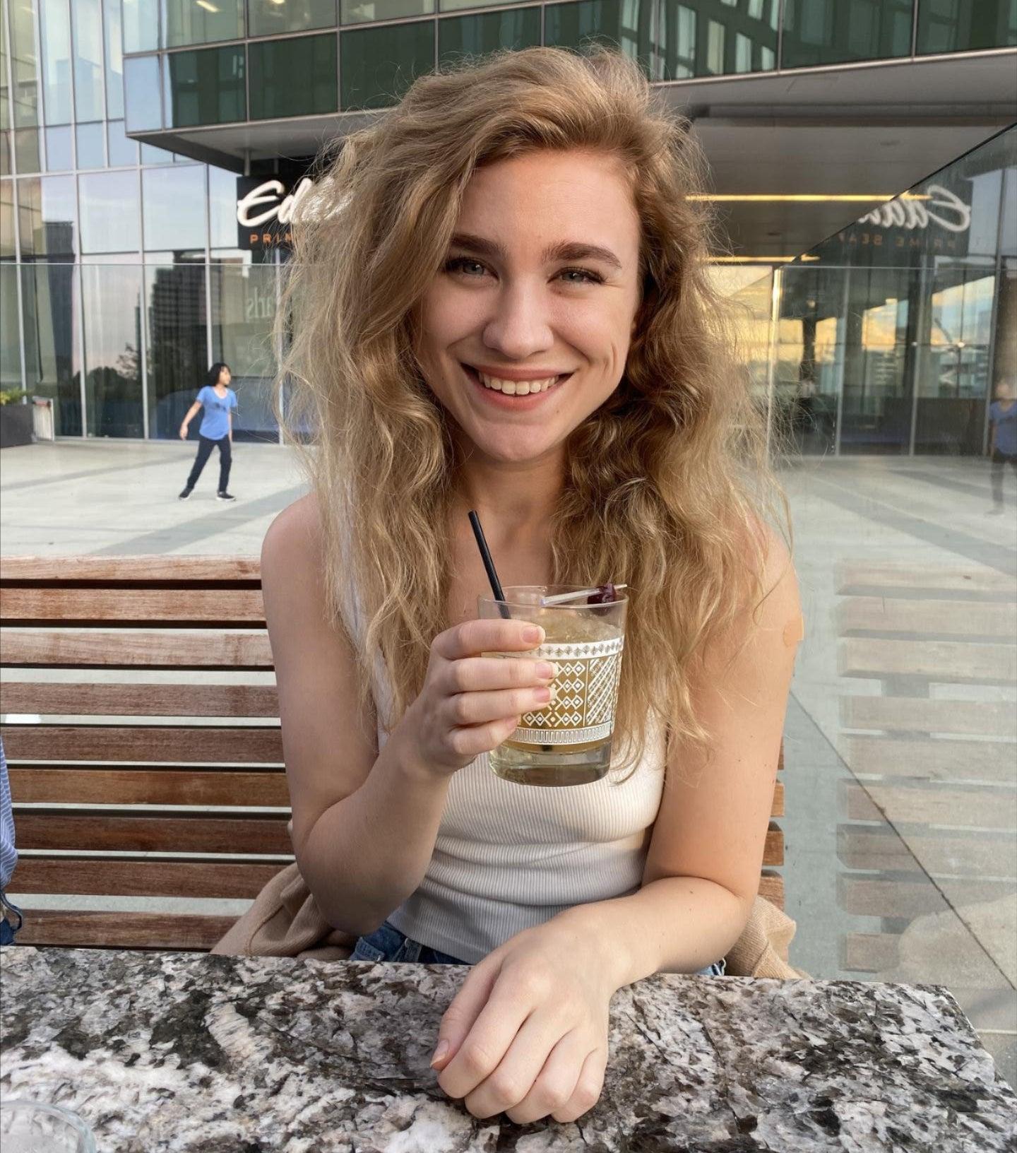 emma holding a drink