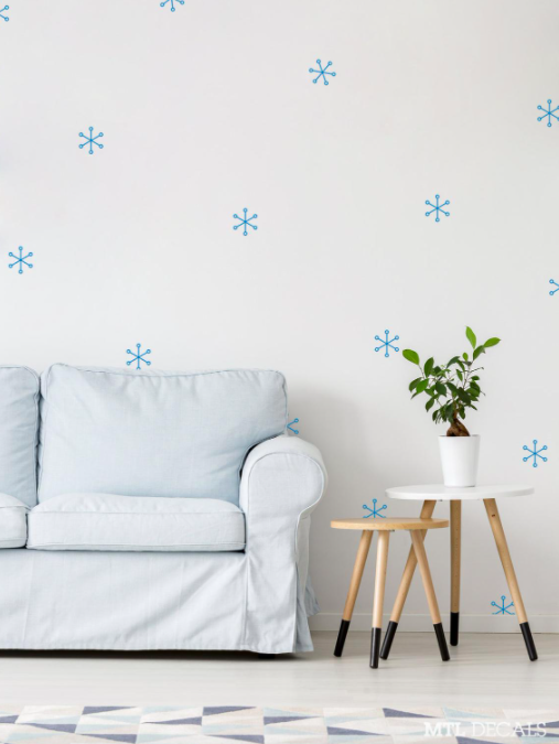 A series of snowflake-shaped decals on a living room wall