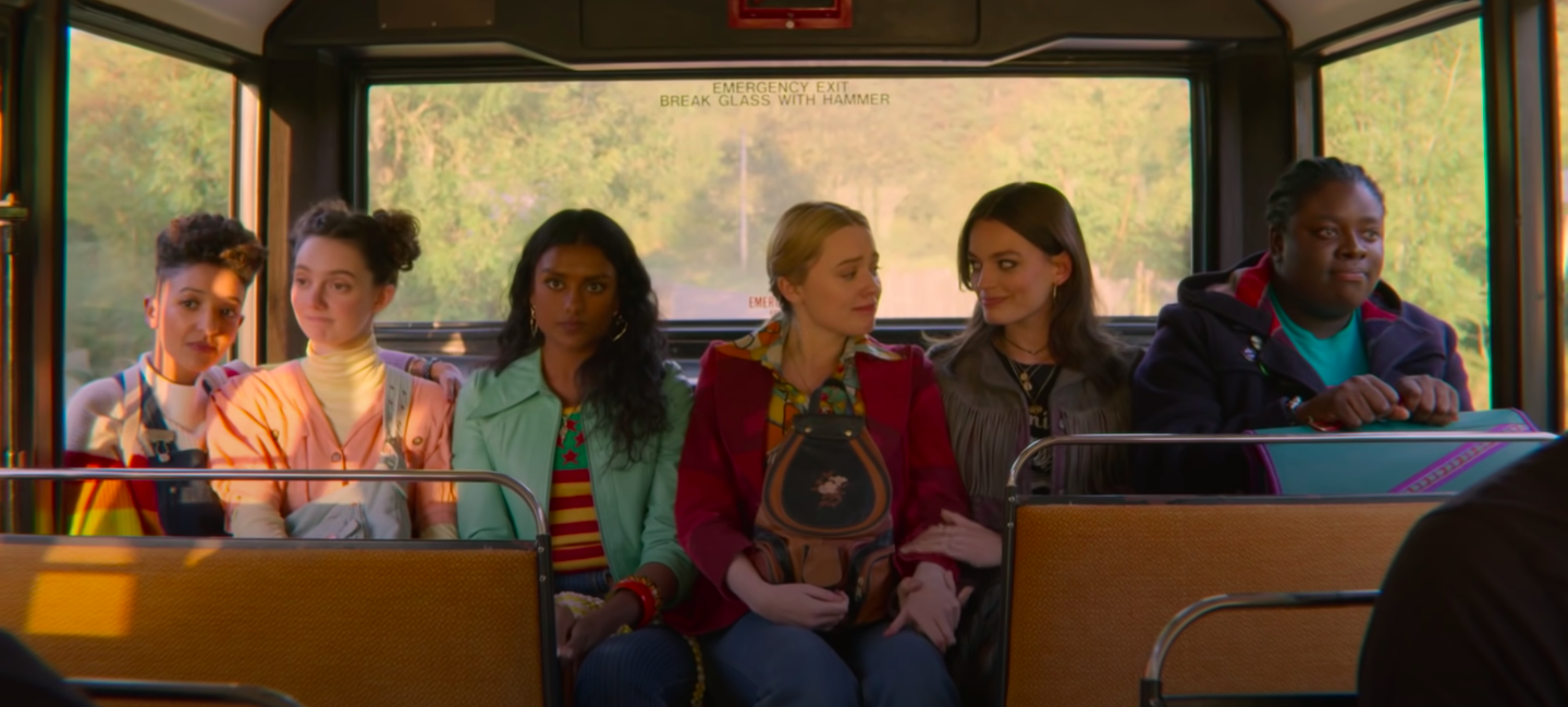 The women of Sex Education on the bus together