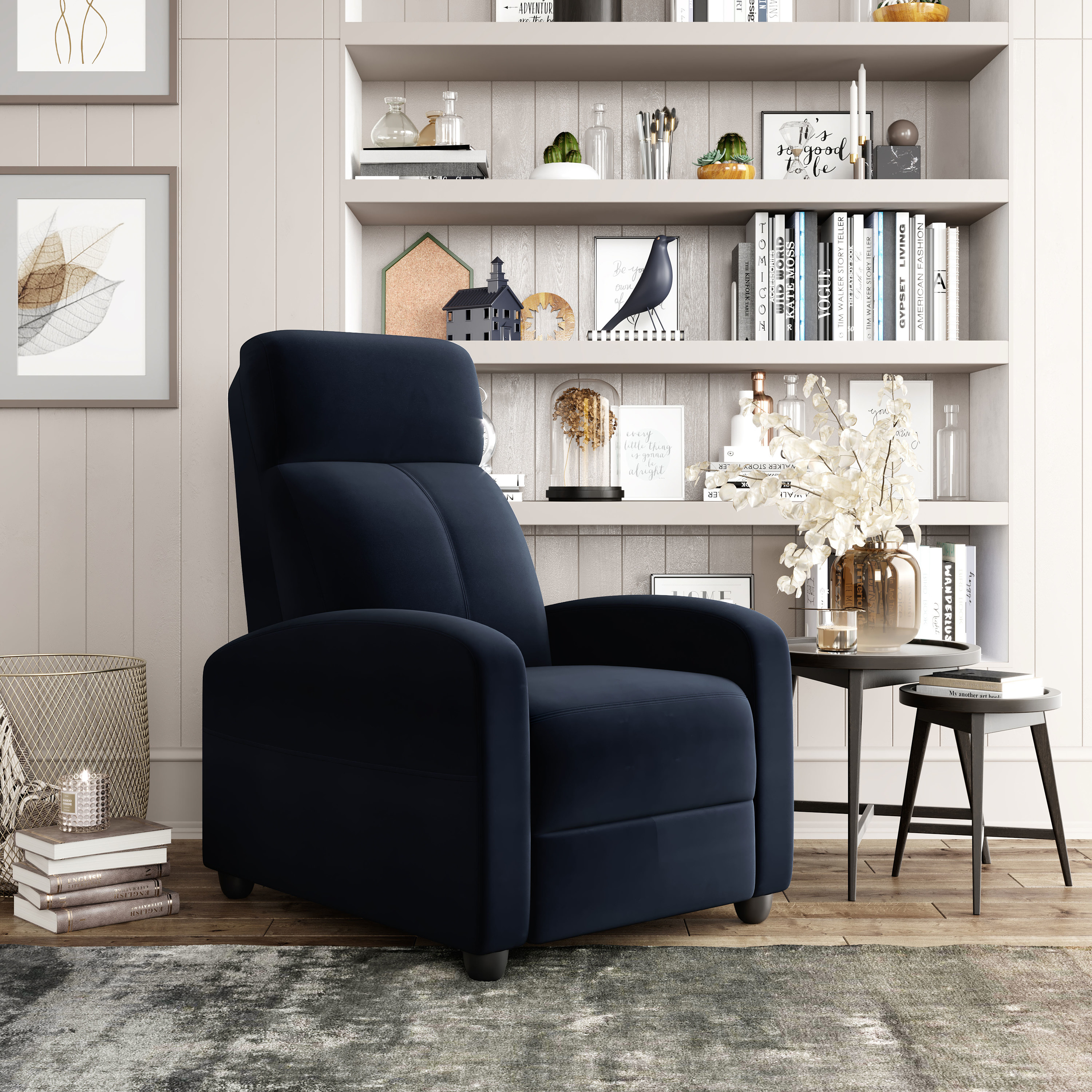 The black recliner in front of a bookshelf
