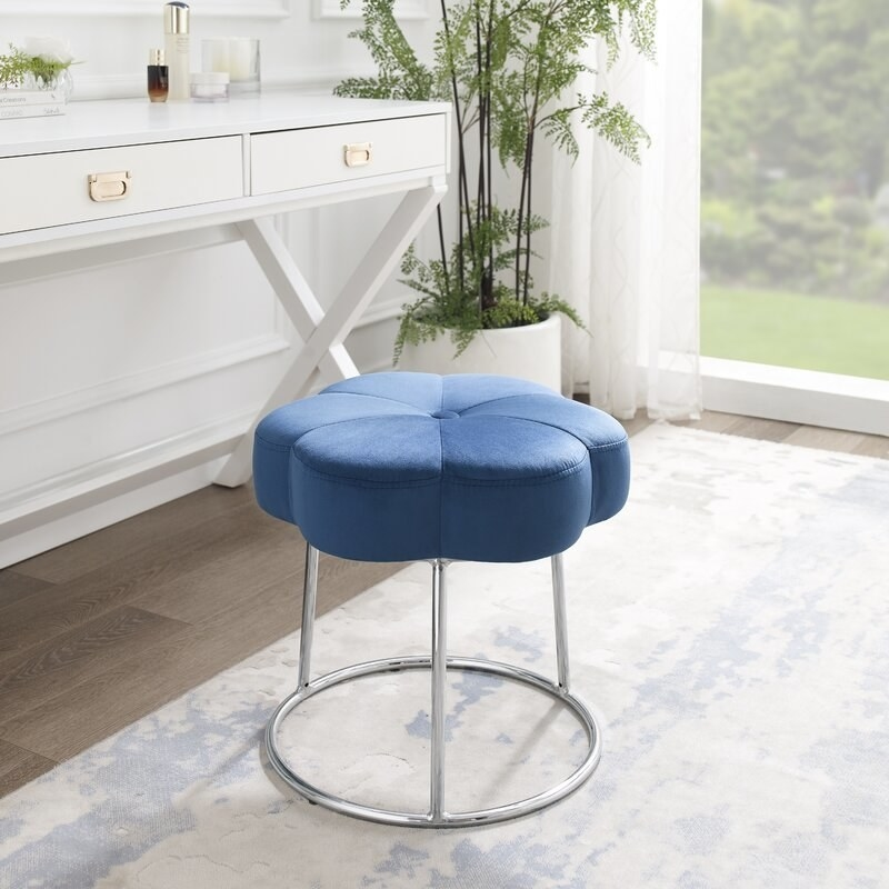 The blue vanity stool