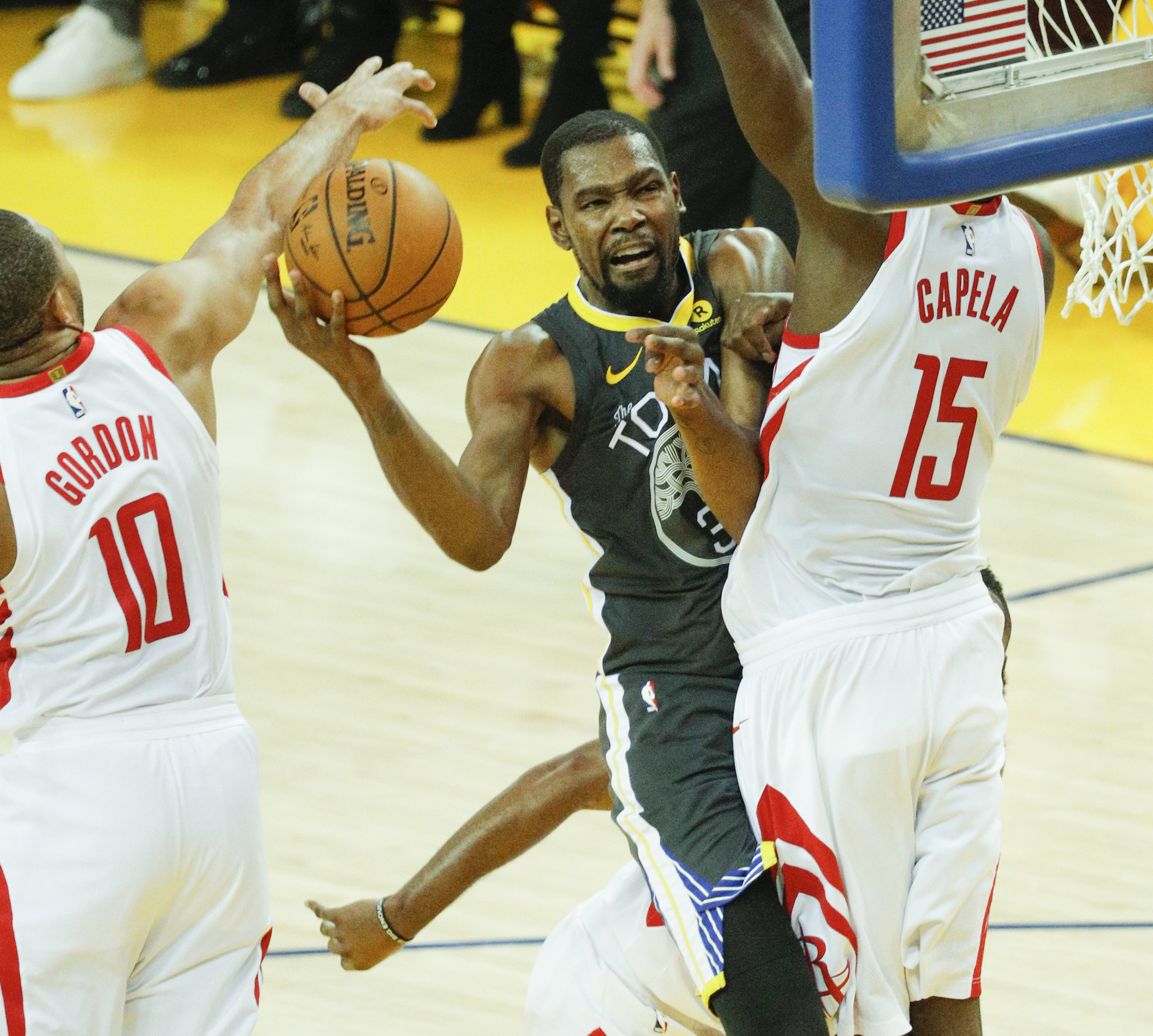 Houston Rockets' Eric Gordon blocks a Golden State Warriors' Kevin Durant layup attempt during game 4 of the Western Conference Finals
