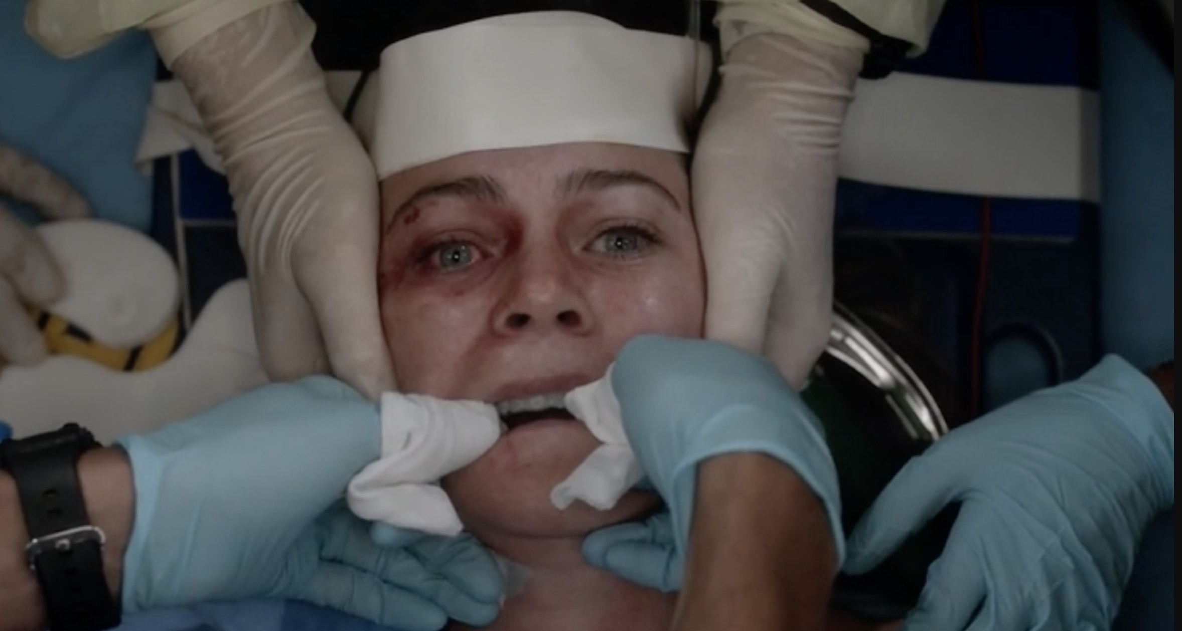 Meredith getting medically cared for by the doctors after she was attacked.