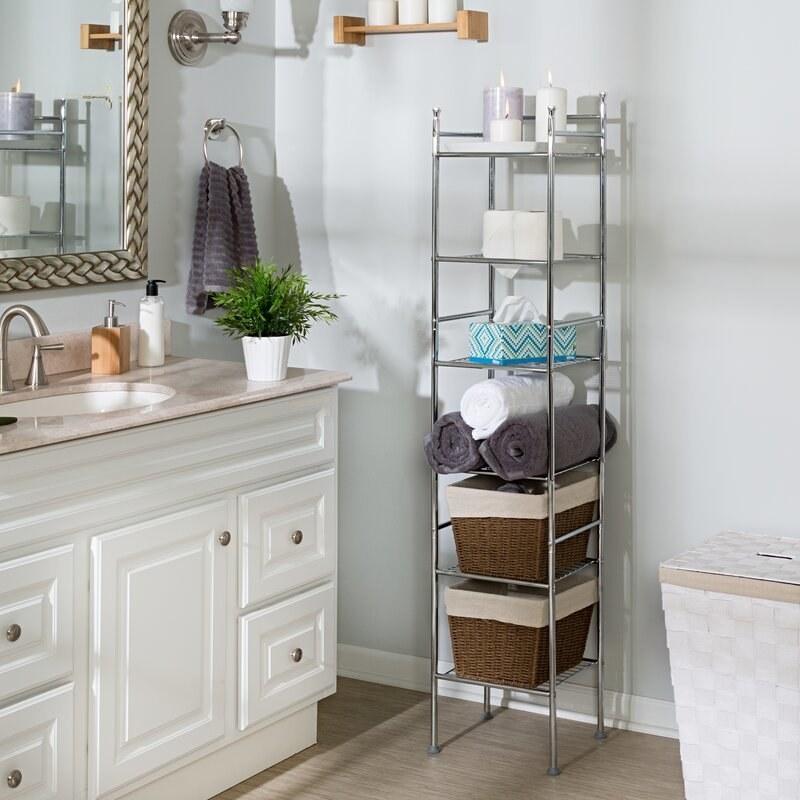 metal bathroom shelf with six shelves holding toiletries and towels