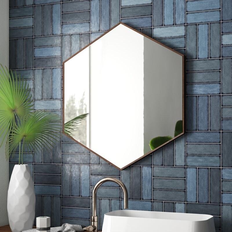 hexagonal mirror hung on wall above sink
