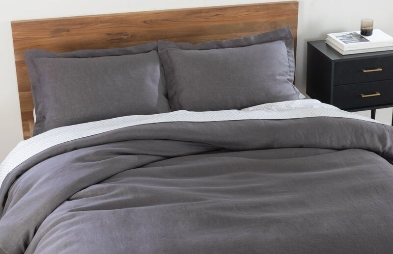 grey duvet cover and pillow shams on a bed