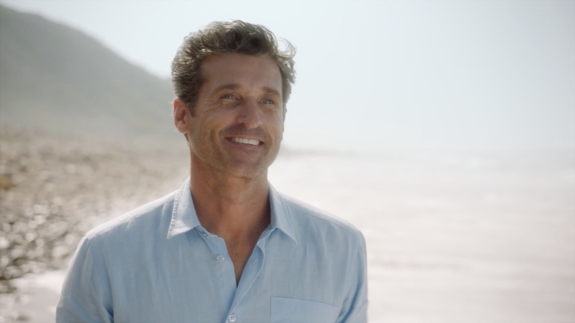 Derek on a beach saying hello to Meredith after she collapses.