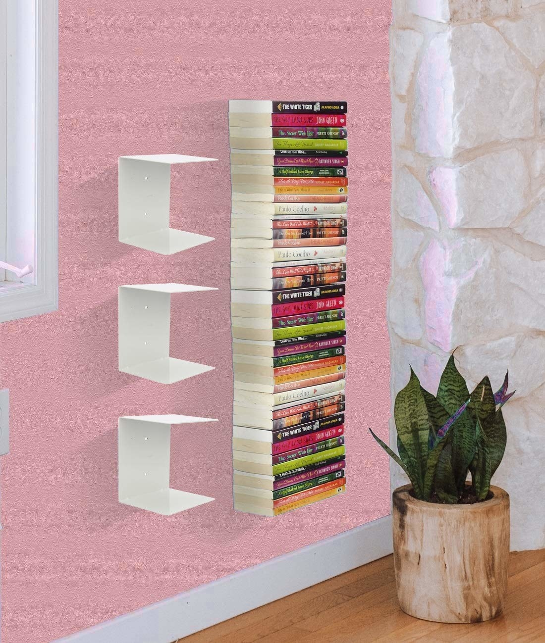 Invisible bookshelf on a wall with books in it
