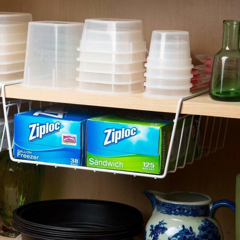 Under shelf basket with ziploc bags in it