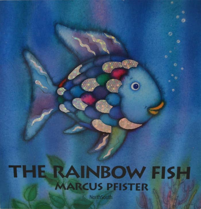 "The book cover for ""The Rainbow Fish"" featuring a blue fish."