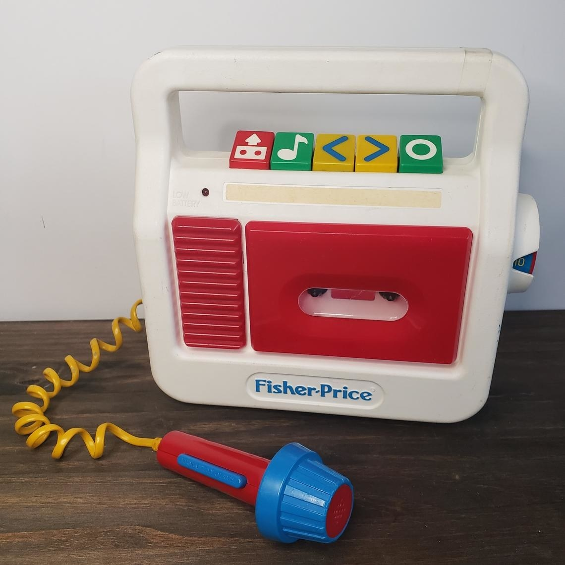 Fisher-Price tape player that comes in red and white and with a red and blue microphone.