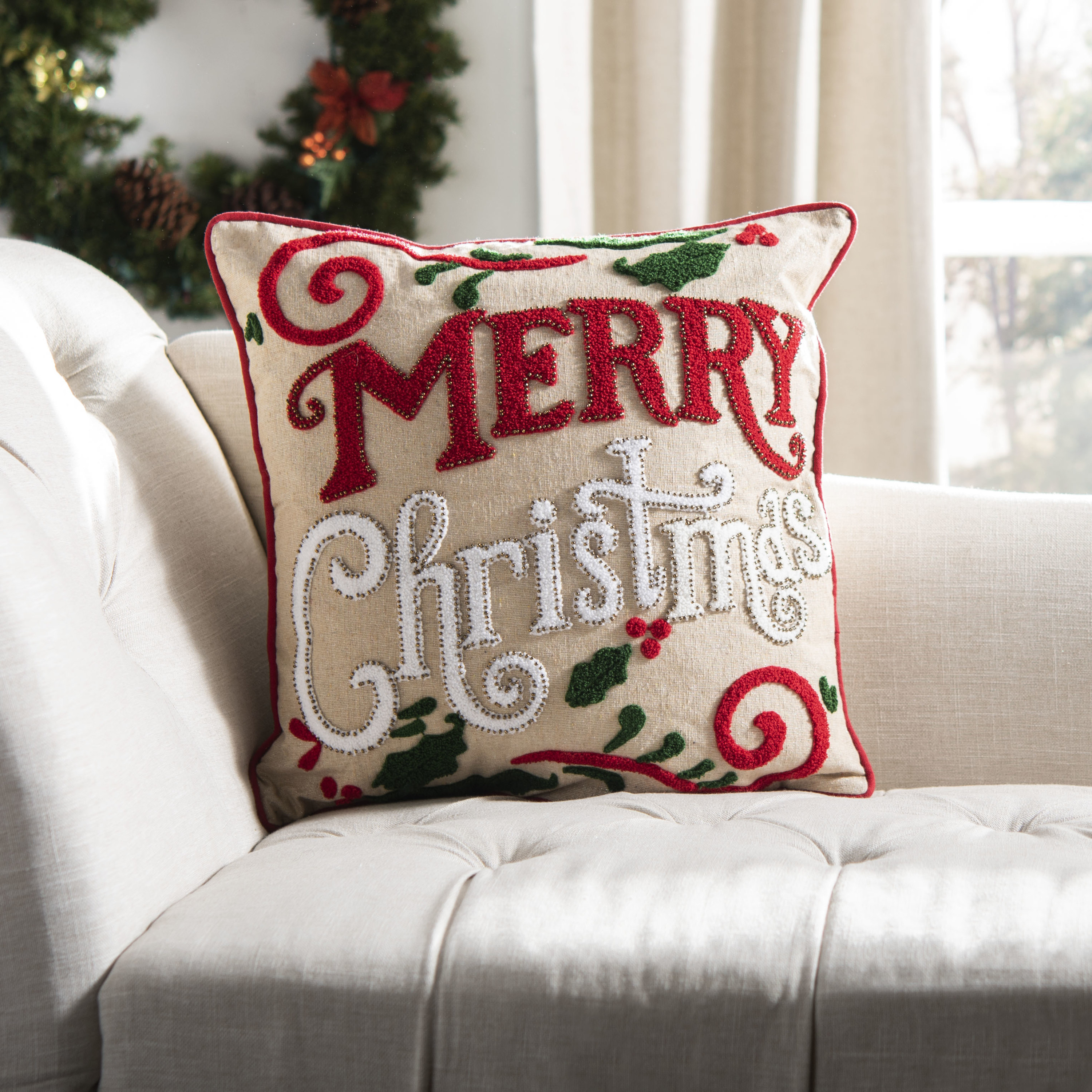 The red and white pillow on a couch