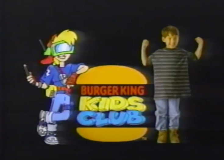 A screenshot of the cartoon mascot for the Burger King Kids Club standing next to a kid and the logo.