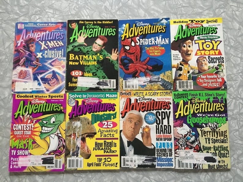 A collection of eight Disney Adventures magazines.