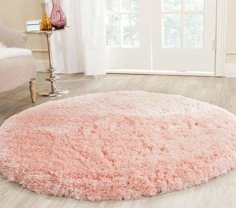 Baby pink round furry rug.