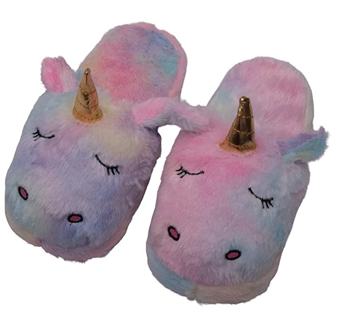 Pink, purple and blue fuzzy slippers with a unicorn horn design.