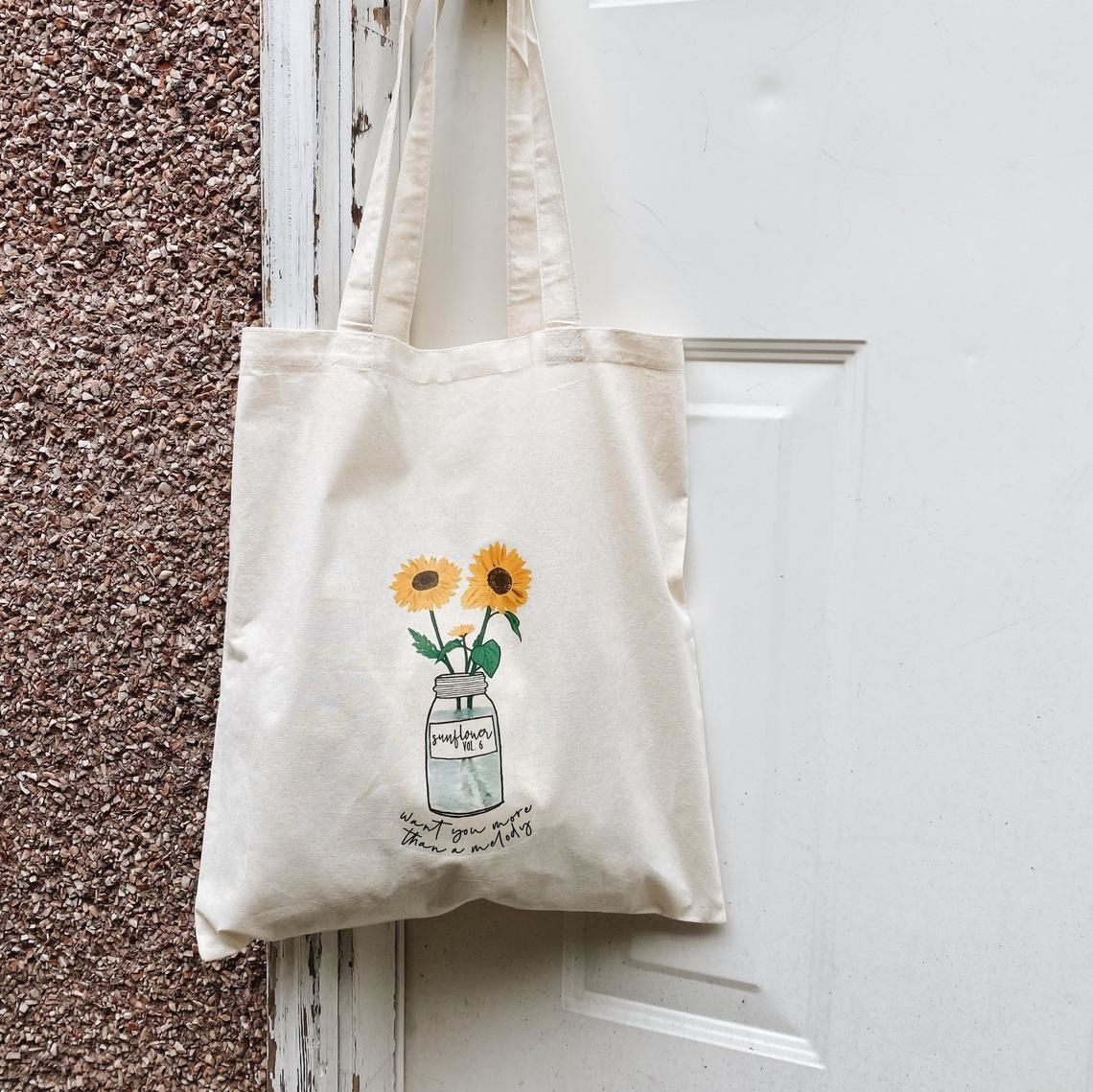The tote bag hanging on a door handle