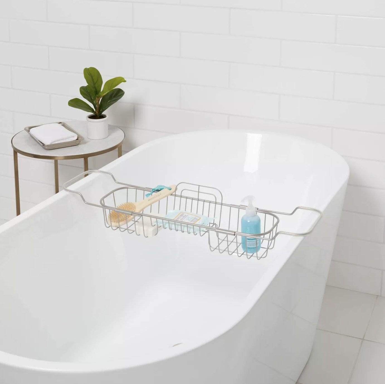 The bathtub caddy on a bathtub