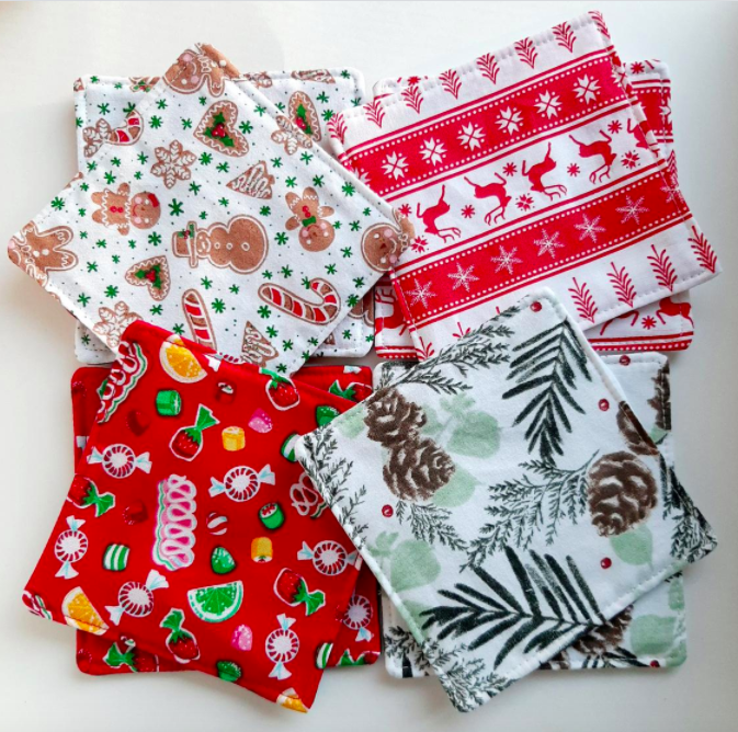 A flatlay of four holiday-themed fabric coasters