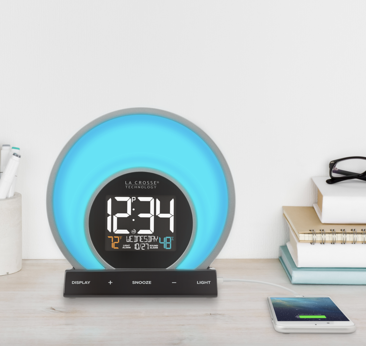 the blue lit alarm clock with an attached phone