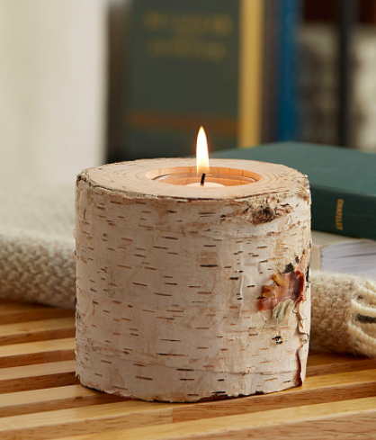 A close up of a birch wood candle holder