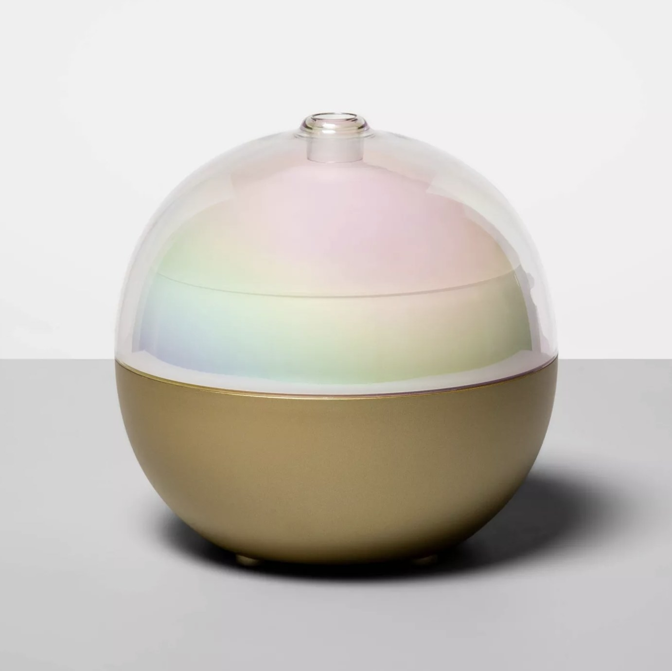 A color-changing oil diffuser with a gold base