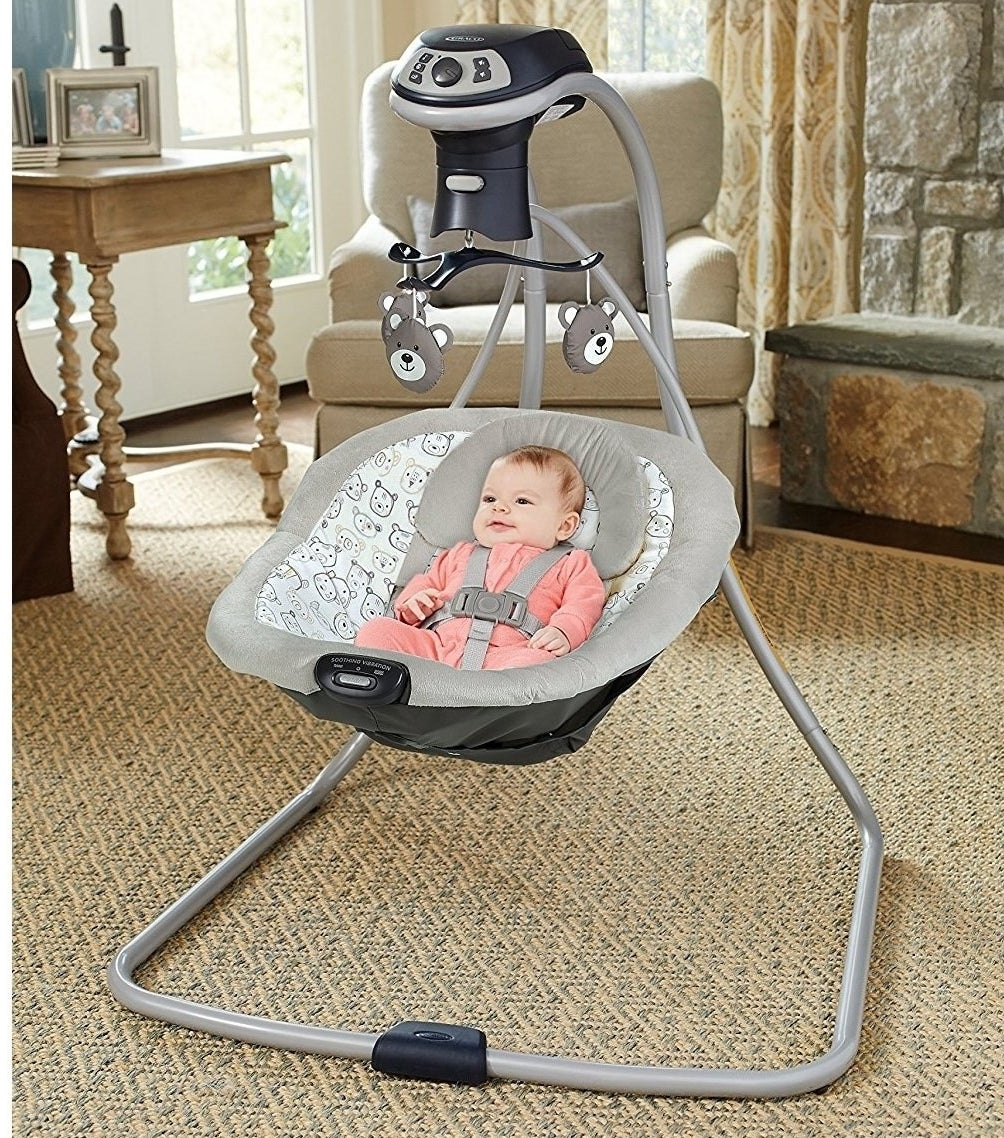 baby in the baby swing
