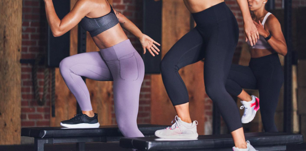 a group of people taking a fitness class in their leggings