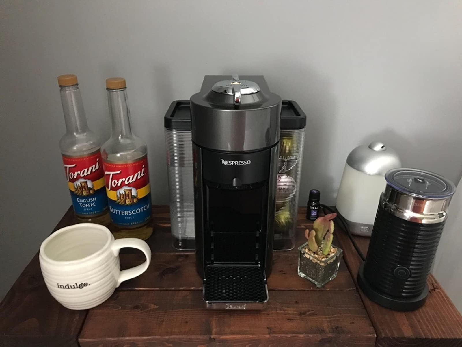 a reviewers coffee station with the nespresso machine