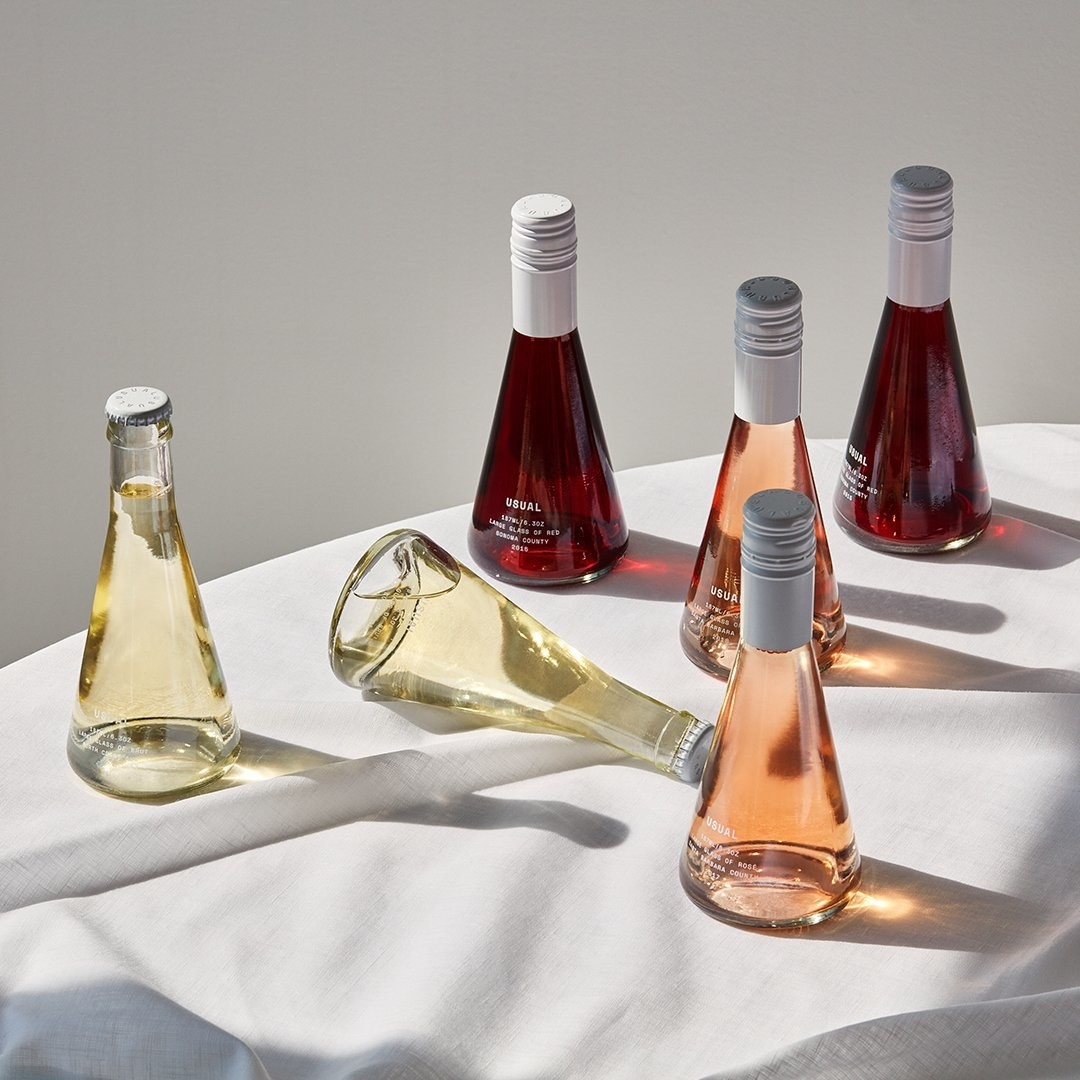 Six bottles of wine on a table; two brut, two rose, and two red