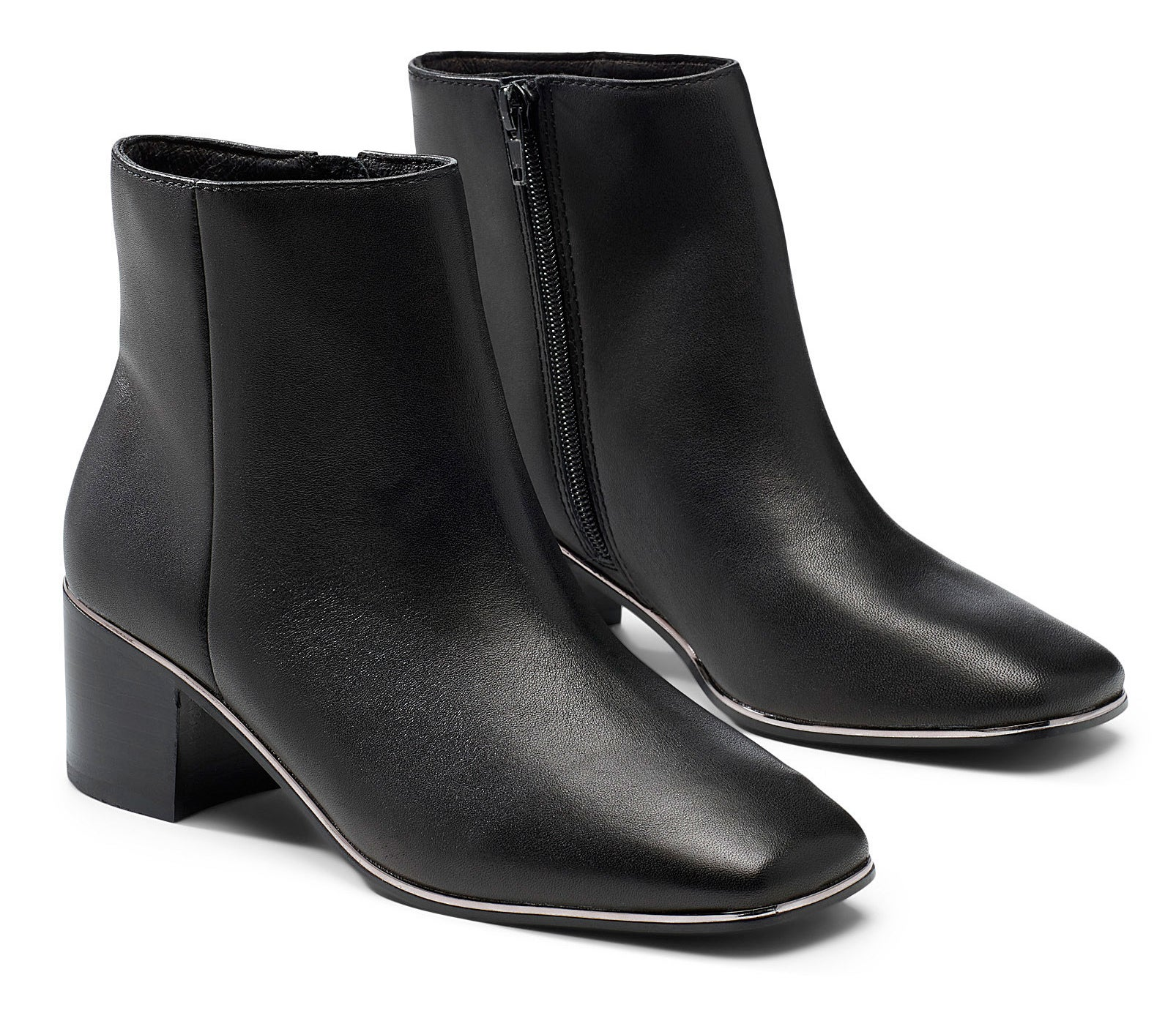 A pair of leather Chelsea boots on a plain background